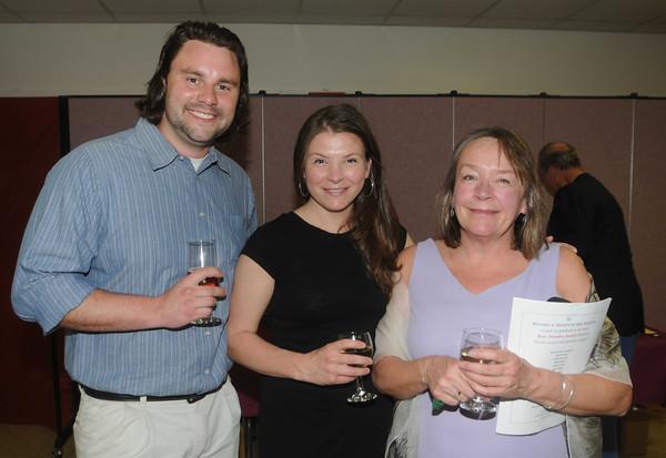 Jake Saunders, Christina Strauss and her mom Cathy Strauss at the 'Bury Treasures Auction at Nicholson Hall in Nerburyport