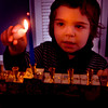 Judah Poupko 3, lights his menorah at his Newburyport home. Jim Vaiknoras/staff photo