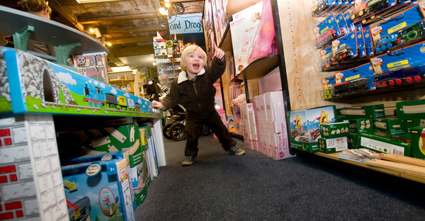 Max Tangen 2, who is visiting his Aunt get excited by the toys at the Dragons Nest in Newburyport.