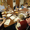 Sandi Schauer, standing,  works with participants at a workshop at the Quilted Acorn in Newbury.