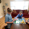 From the left: Kiara. Lena, and Hanna Ashe play Sorry at their Newburyport home.