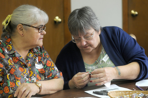 Susan Maguire shows Sheila a stitch while at a workshop at the Quilted Acorn.