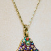 A hamsa, Jewish healing hands, neckless at Annie's Gifts in Newburyport