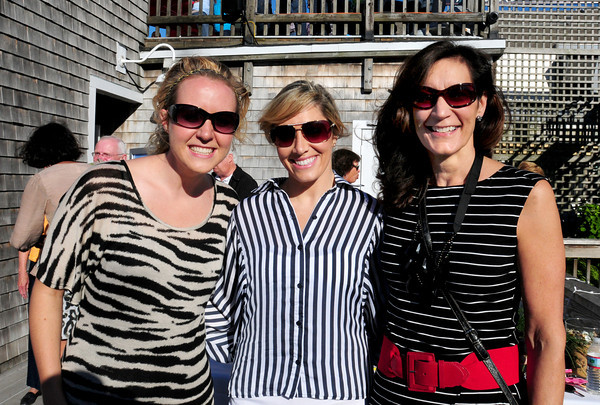 Newburyport Brianne Records and Cassandra Leone of Newburyport and Lisa Wetenkamp of Newbury at the opening of Michael's Harborside new bar The Laning. Bryan Eaton/Staff Photo