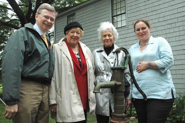 Historic New England celebrated the reopening of a 19th century farmhouse inside the Spencer-Peirce-Little Farm yesterday during its annual Plow Day event. From left, Historic New England president Carl Nold, Olga MacFarlane, Nancy Graf and Bethany Groff from Historic New England stand in front of the house occupied by the Stekionis family from 1913 to 1994.Dave Rogers/staff photo