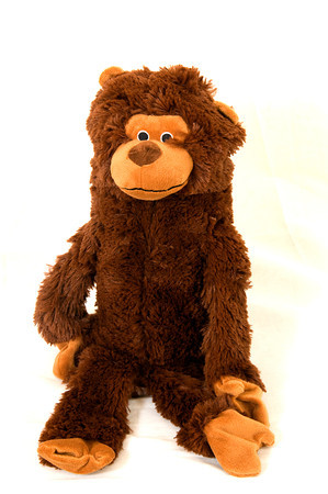 Doggle Soda Pop Critter Monkey, holds a replacable 2 liter enpty plastic bottle inside. retail $17.99