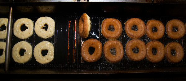 Cider donuts being made on a Belshaw Donut Machine at  Cider Hill Farm in Amesbury.