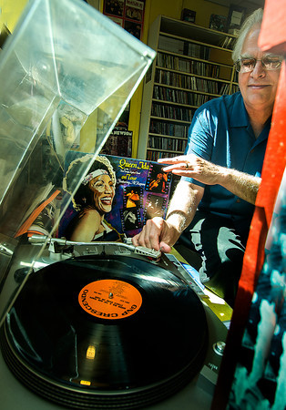 Owner Richard Osbourne of Dyno Record puts on a Queen Ida album on the turn table at his store.