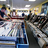 Trevor Updike looks through vinyl records at Dyno Records in Newburyport.