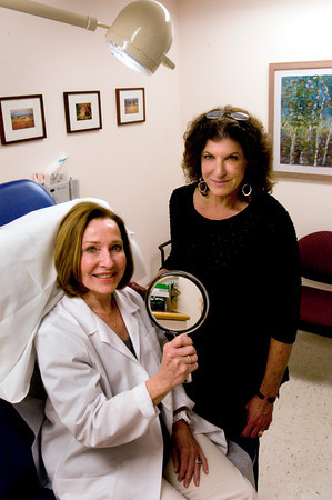 Newburyport: Anne M. Connolly, left, of Timeless Faces, an advanced  skin care clinic, left, and Michele T. Sasmor, MD, of River Song Plastic Surgery use a mirror when consulting with prospective patients. Bryan Eaton/Staff Photo