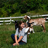 Erin Bligh of Dancing Goat Dairy with her goats.... at the Tendercrop Farm in Newbury.