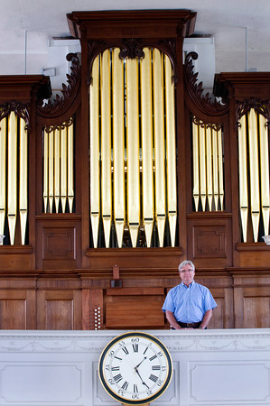 Newburyport: Bill Heenehan, one of the principals in restoring the rare Joseph Alley organ, at the First Religious Society. Bryan Eaton/Staff Photo