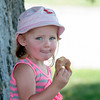 Lillian McCarthy , 3, enjoys a cider donut at the Cider Hill Farm in Amesbury.