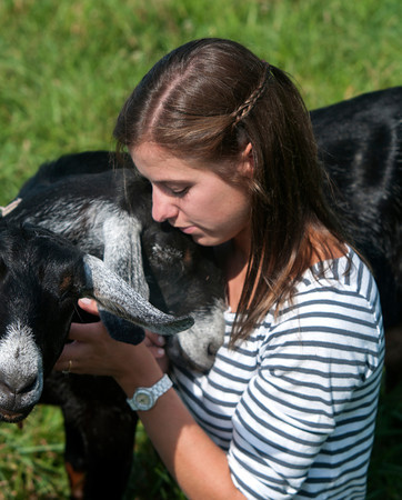Erin Bligh of Dancing Goat Dairy with her goats ..... at the Tendercrop Farm in Newbury.