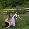 Erin Bligh of Dancing Goat Dairy with her goat ..... at the Tendercrop Farm in Newbury.