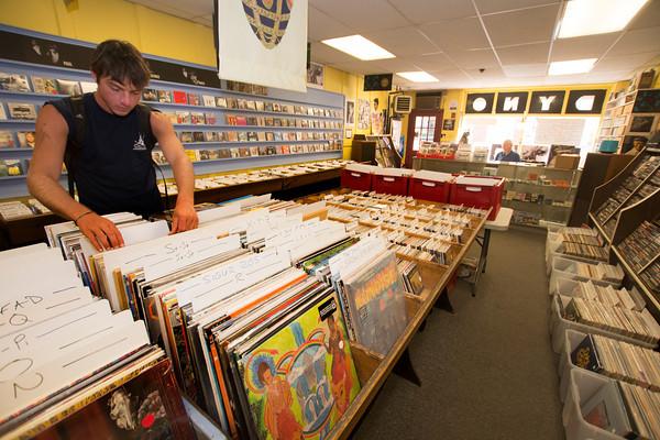 Trevor Updike looks through vinyl records at Dyno Records in Newburyport.