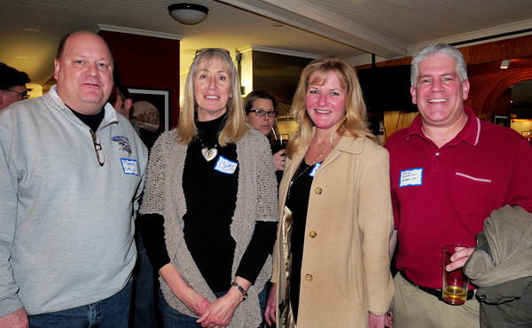 Carl Norloff of Rheebo, Cathy Moulton, owner of 17 State Street, Susan Signori and Brian Derrivan, both of Rheebo. Bryan Eaton/Staff Photo