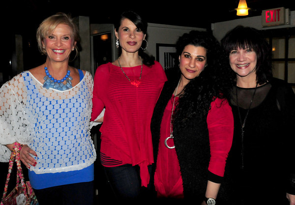 Models Joan Kerble, Lisa Camara with Alanna and June Pastman of Smitten. Bryan Eaton/Staff Photo