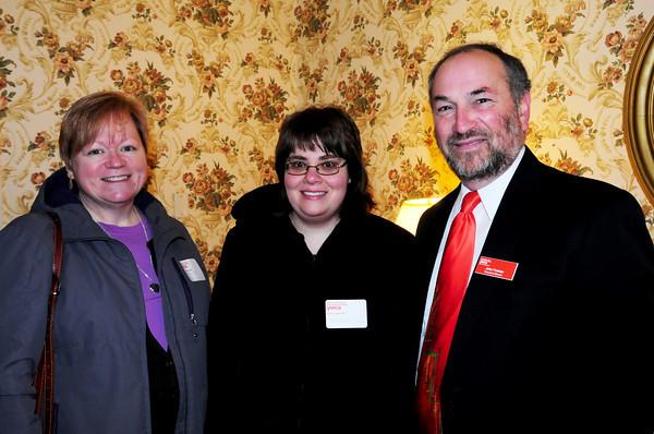 Martha Daigle, Coastal Connections, Stephanie Caron, YWCA and YWCA Executive Director John Feehan. Bryan Eaton/Staff Photo