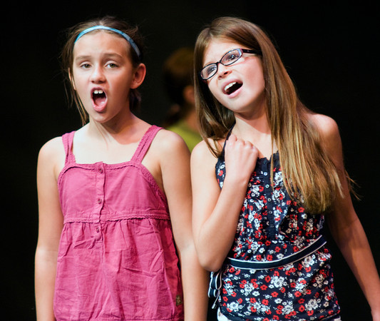 Emily Ney and Cassandra Plisinski sing at the Glee Club program at the Firehouse