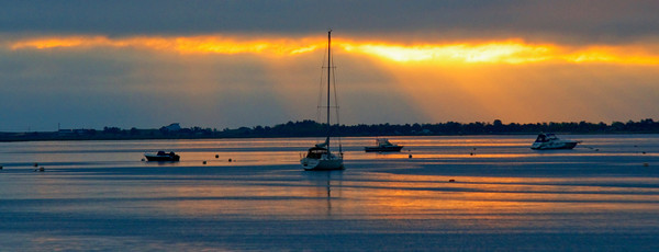 The rising sun is refected off the waters of the Merrimack River off Newburyport. Jim Vaiknoras photo
