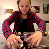 Aquinnah Wehrwein, 9, lays out her cupcakes at Eat Cake in Newburyport