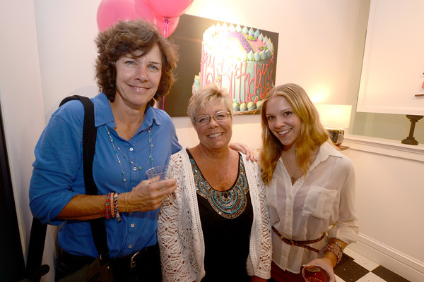 Karen Grutchfield, Ruth Listro and her daughter Olivia at the 10th anniversary party for Eat Cake on Inn Street, they are naighbors of owner Hilary Larson.