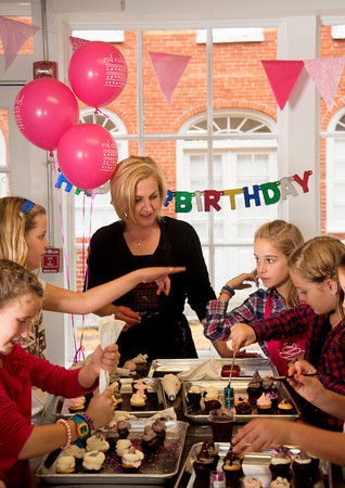 Hilary Larson runs a birthday party at her store Eat Cake on Inn Street in Newburyport.