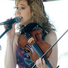 JIM VAIKNORAS/Staff photo <br /> Trish DeCaprio of Black Water Moon performs at the Fourth annual Byfield Music and Arts Festival at Manter Field in Byfield Saturday.