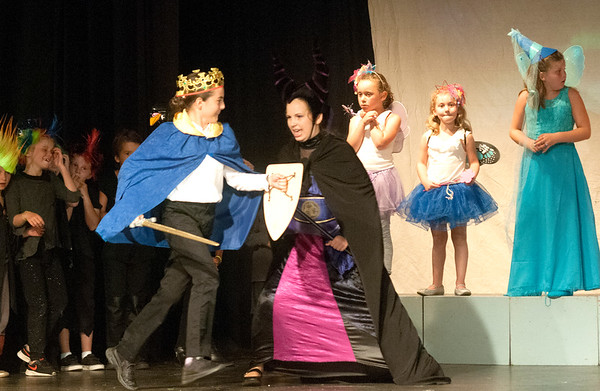 JIM VAIKNORAS/Staff photo Ella Lane, as Maleficent, battles Izabella Markovic as Prince Phillip in the Take The Stage production of Sleeping Beauty at the Byfield Community Arts Center.