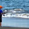 JIM VAIKNORAS/Staff photo  Grady Booth , 7, fishes on the beach on Plum Island.