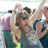 JIM VAIKNORAS/Staff photo Kelly Holmes dances  at the Fourth annual Byfield Music and Arts Festival at Manter Field in Byfield Saturday.