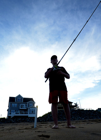 JIM VAIKNORAS/Staff photo Jake Wyman, 13, of Plastow NH  fishes on the beach on Plum Island.