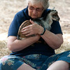 JIM VAIKNORAS/Staff photo JOanne Mills holds one of the goats at Moon Shadow Goat Yoga in Boxford..