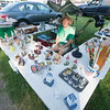 JIM VAIKNORAS/Staff photo Paul Zakszewski of Watertown sells his items at Todd Farm in Rowley on a bright warm Sunday morning.