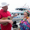 JIM VAIKNORAS/Staff photo Bob Videylko as Gilligan and Sherry Bonder as a native girl sing at The Gilligan's Island Costume Fundraiser Cruise Hosted by The Actors Studio of Newburyport on teh Newburyport Waterfront.