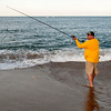 JIM VAIKNORAS/Staff photo  Clay Patles casts his line the beach on Plum Island.