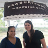 JIM VAIKNORAS/Staff photo Alex Stiles and Julia Weiner of Newburyport Brewing Company at the Yankee Homecoming Brewfest.