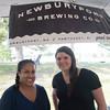 JIM VAIKNORAS/Staff photo Alex Stiles and Julia Weiner of Newburyport Brewing Company at the Yankee Homecoming Brewfest.