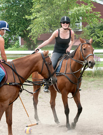 JIM VAIKNORAS/Staff photo Anna Behrens of Beverly plays polo during a class at Stage Hill Farm in Newbury.