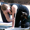 JIM VAIKNORAS/Staff photo Cara Cote, 18, of Boxford uses her phone to take a photo of one of the goats at Moon Shadow Goat Yoga in Boxford.