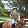 JIM VAIKNORAS/Staff photo Steven Rudolph teaches a polo class at Stage Hill Farm in Newbury.