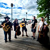 JIM VAIKNORAS/Staff photo Two Weeks From Everywhere perform at the boardwalk in Newburyport. From Left  Mark Aleo, Lowell, on mandolin,Lauren Parks, Boston, on cello, Ed Novak, Georgetown,on guitar,  Robert Stalvey, North Andover, on harmonica  and Jay LaBelle, Merrimac, on  bass.