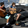 JIM VAIKNORAS?staff photo   Nick Brescio and Nico Gonzalez performing on the board walk in Newburyport.