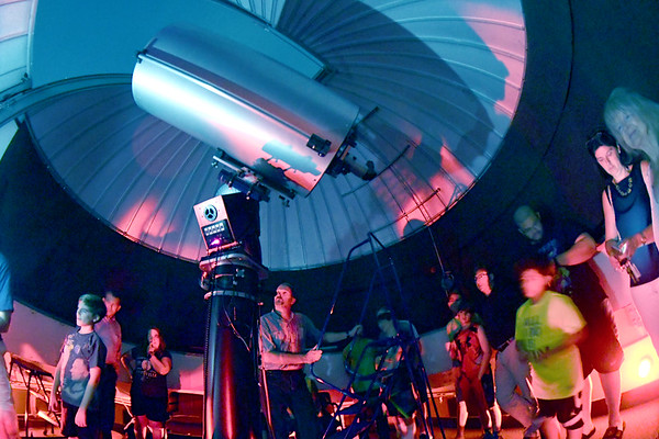 JIM VAIKNORAS/Staff photo Visitors use the Optical Guidance Systems 20-inch Ritchey-Cretien reflector at Merrimack College at Jupiter. They was there for the free Wednesday night program with the North Shore Amateur Astronomy Club.