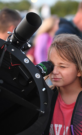 JIM VAIKNORAS/Staff photo Addison Ingrham, 10, looks at Venus at North Shore Amateur Astronomy Club (NSAAC) star party at Salisbury Beach Reservation. She was surprised to learn that Venus has phases just like the moon.