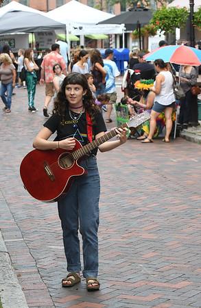 JIM VAIKNORAS/Staff photo Annabelle Lord-Patey of Beverly performs on Inn Street in Newburyport.