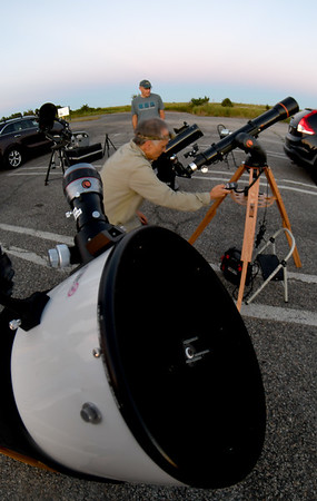JIM VAIKNORAS/Staff photo Charlie Hall and John Brueker set up their telescope at North Shore Amateur Astronomy Club (NSAAC) star party at Salisbury Beach Reservation.