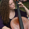 JIM VAIKNORAS/Staff photo Lauren Parks of Boston,plays cello with Two Weeks From Everywhere at the board walk in Newburyport.