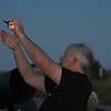 JIM VAIKNORAS/Staff photo Star Party Coordinator Brewster LaMacchia uses a ball to explain the phases of the moon at North Shore Amateur Astronomy Club (NSAAC) star party at Salisbury Beach Reservation.